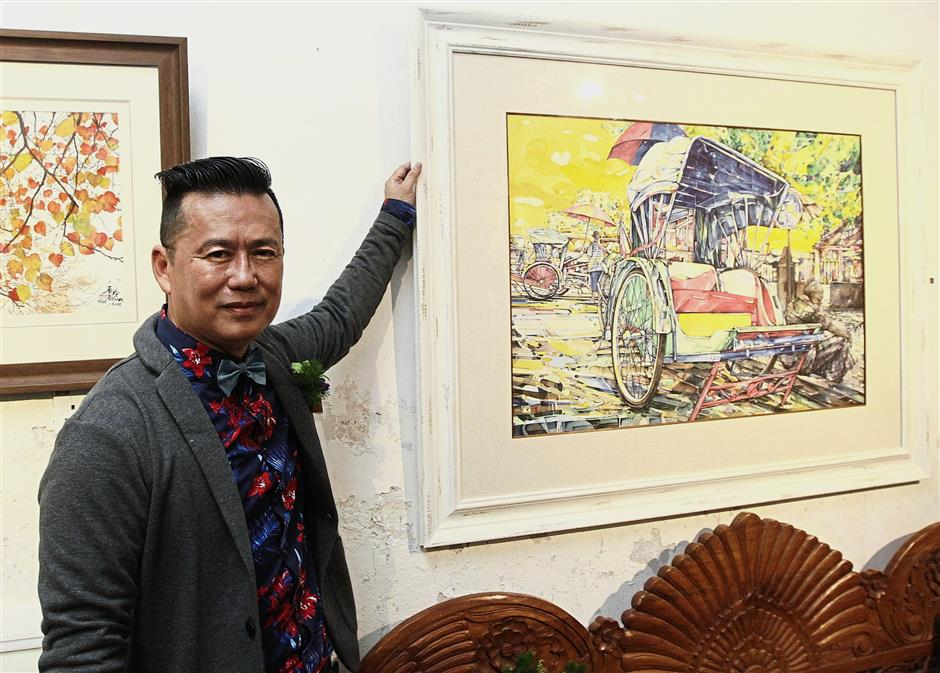 Penangite Cheng showing his artwork of a trishaw pedaller waiting for customers.