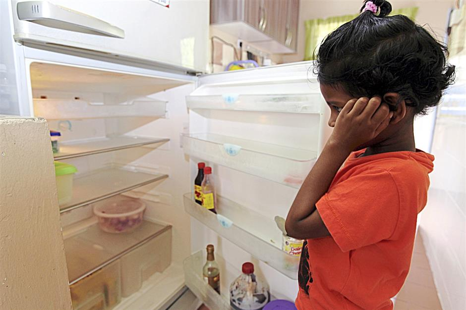 Bare essentials: The family-run shelter is running on empty when it comes to feeding the children.