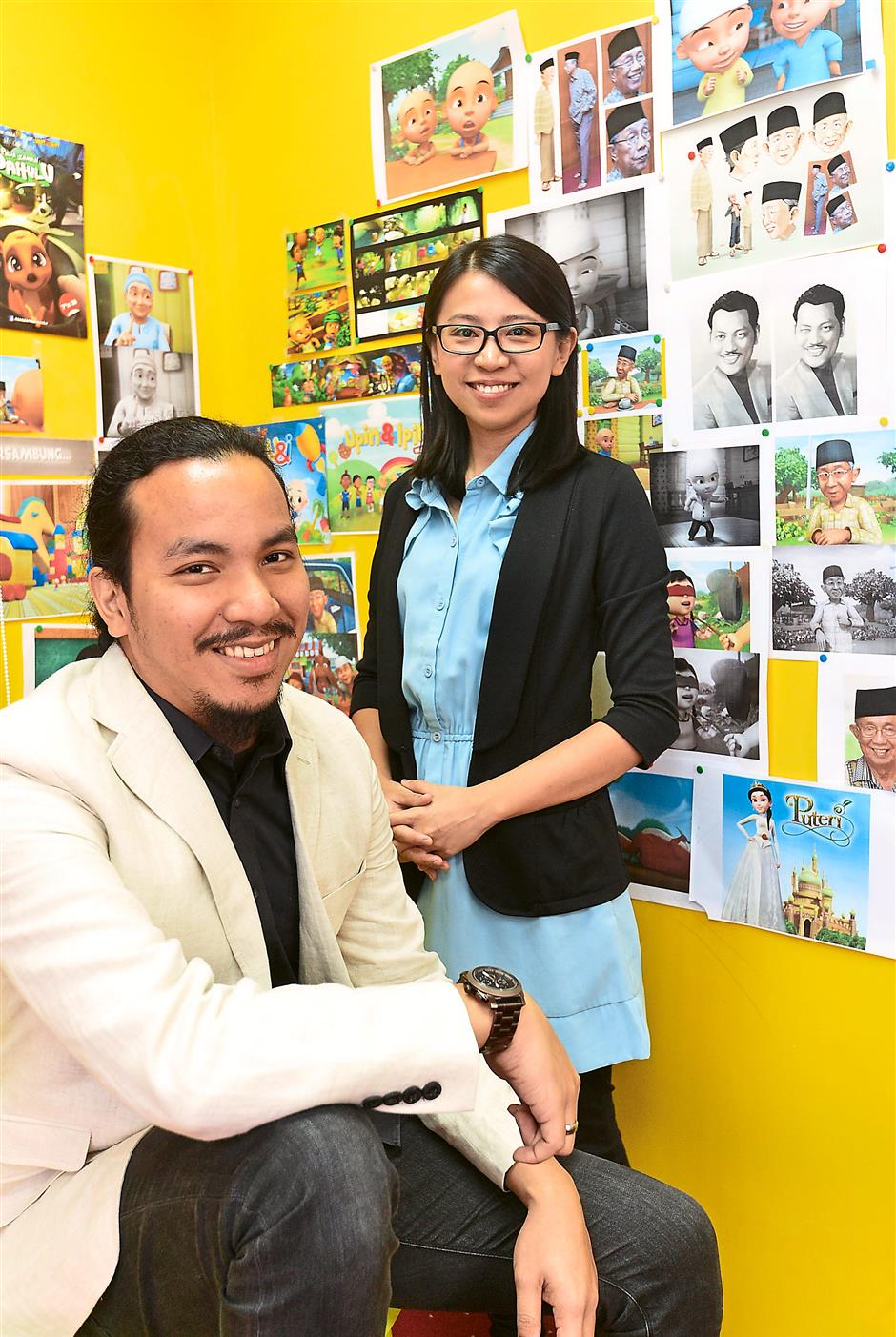 Young blood: Syed (left) and Tang are part of Les' Copaque's team which is mostly made up of fresh graduates.