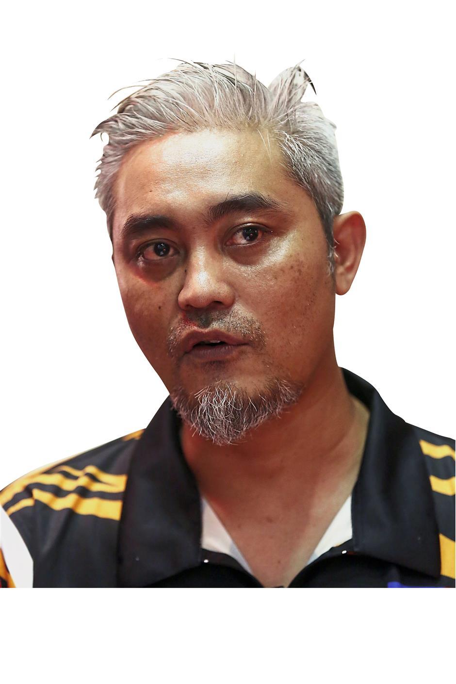 Apache Angels coach and Malaysias professional darter Rosidi Puasa was proud of his trainee. IZZRAFIQ ALIAS / The Star. February 4, 2018.