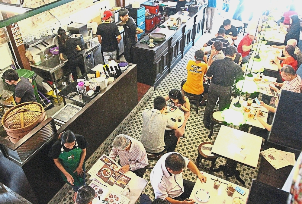 Ho Kow Hainan Kopitiam retains the old coffeeshop culture despite being a new establishment. — Photos: LOW BOON TAT/The Star