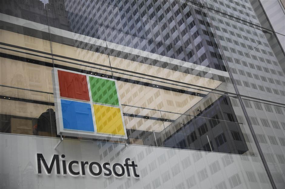 NEW YORK, NY - JUNE 4: The Microsoft store on Fifth Avenue in Midtown Manhattan is shown June 4, 2018 in New York City. Microsoft officially announced today an agreement to buy GitHub, a code repository company popular with software developers, for $7.5 billion in stock.   Drew Angerer/Getty Images/AFP == FOR NEWSPAPERS, INTERNET, TELCOS & TELEVISION USE ONLY ==
