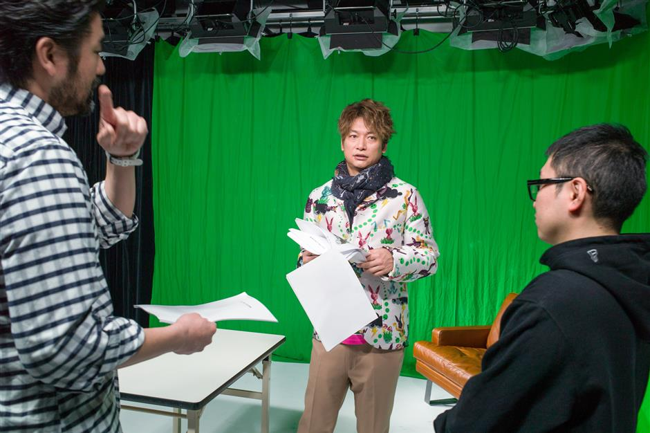 Shingo Katori, a singer, actor and televison host, middle, attends a meeting with his staff in Tokyo, Japan, on Jan. 15, 2018. Katori, as a member of SMAP - one of Japan's most successful boy bands - and decades as a ubiquitous TV presenter, finally decided in November it was time to get an Instagram account. A small step for one celebrity highlights a sea change for the advertising industry in Japan, which has lagged much of the developed world in switching from old to new media. Photographer: Kentaro Takahashi/Bloomberg