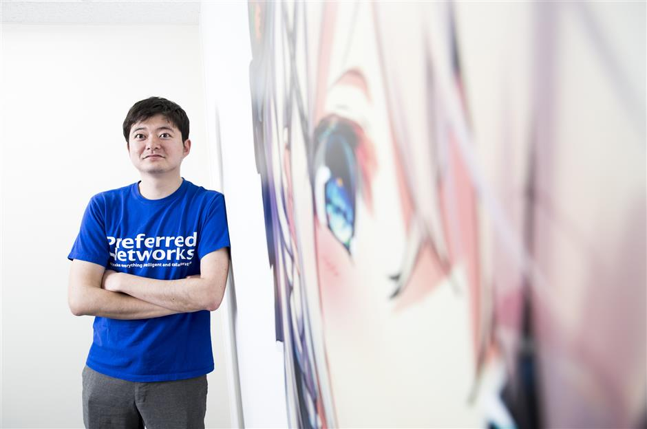 Toru Nishikawa, co-founder and chief executive officer of Preferred Networks Inc., poses for a photograph in Tokyo, Japan, on Friday, March 16, 2018. Preferred Networks has only one publicly available product, a whimsical application that uses artificial intelligence to automate the coloring of manga cartoons. Yet the four-year-old firm has become Japanu2019s most valuable startup, with a venture capital funding that priced it at more than $2 billion, according to people familiar with the matter. Photographer: Tomohiro Ohsumi/Bloomberg