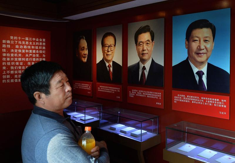 Portraits of Chinese President Xi Jinping (R), along with his predecessors (R-L) Hu Jintao, Jiang Zemin and Deng Xiaoping, on display at a museum in Tianjin. China\'s ruling Communist Party started the Central Committee\'s Third Plenum meetings in Beijing which are expected to focus on economic reforms a year after a closely watched leadership transition - AFP Photo.