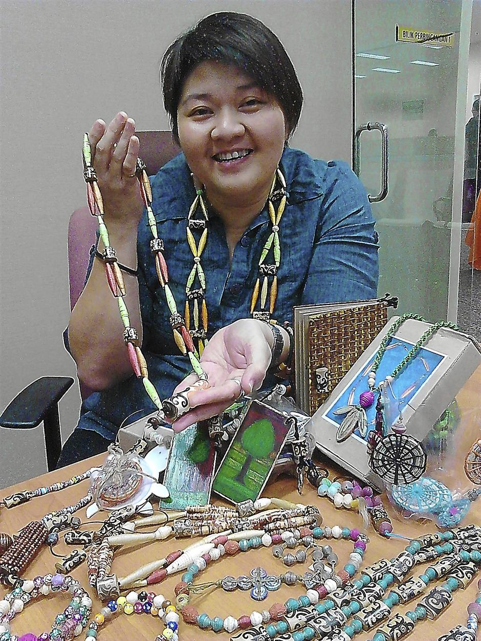 Kiew Boon Siew showcasing some of the craft work by children and adults  with special needs.