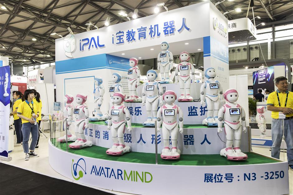IPal teaching robots stand on display at the AvatarMind booth at the CES Asia 2018 show in Shanghai, China, on Wednesday, June 13, 2018. The show runs through June 15. Photographer: Qilai Shen/Bloomberg