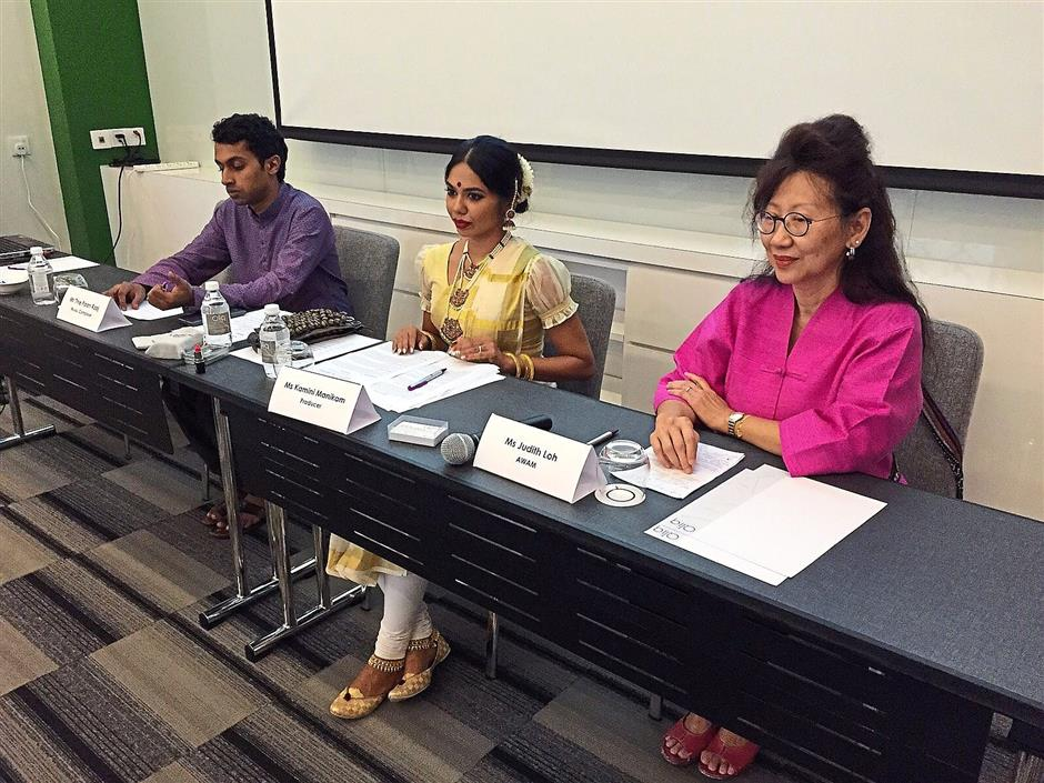 (From left) Music composer Thiepaan Raaj, Kamini and Awam representative Judith Loh at a press conference.