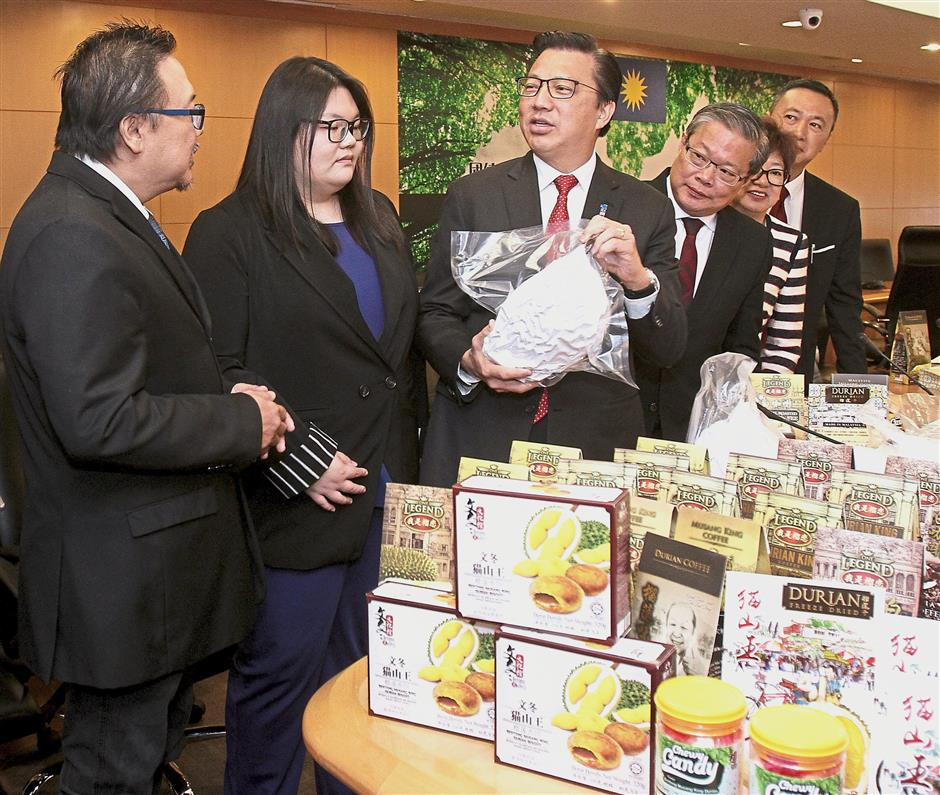 Sweet deal: Liow checking out the various durian products after witnessing the MOU signing ceremony between Malaysia and China.