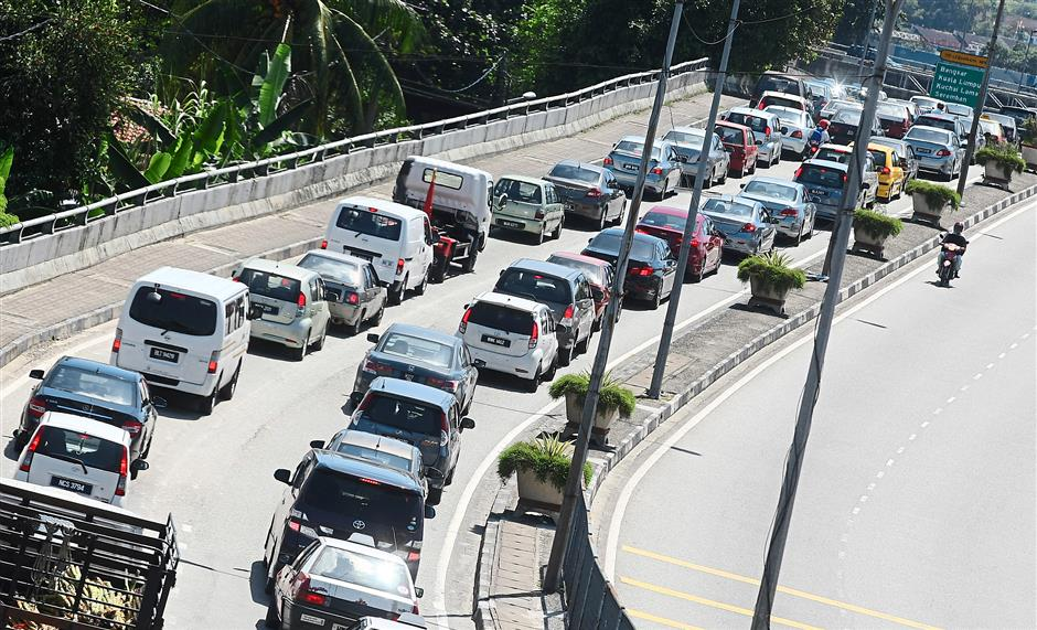 Congested: Motorists stuck in a standstill traffic jam before the junction to Jalan Klang Lama from Templer roundabout. The photo was taken at noon yesterday.