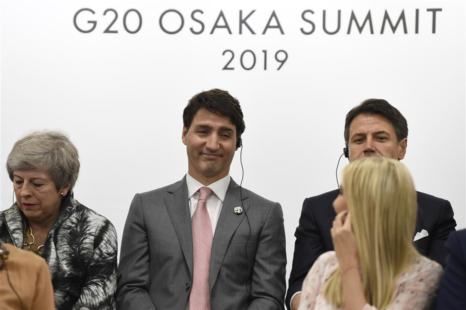 Ivanka Trump, right, turns back to look at Canadian Prime Minister Justin Trudeau, center, during a G-20 summit event on women\'s empowerment in Osaka, Japan, in Osaka, Japan, Saturday, June 29, 2019. (AP Photo/Susan Walsh)