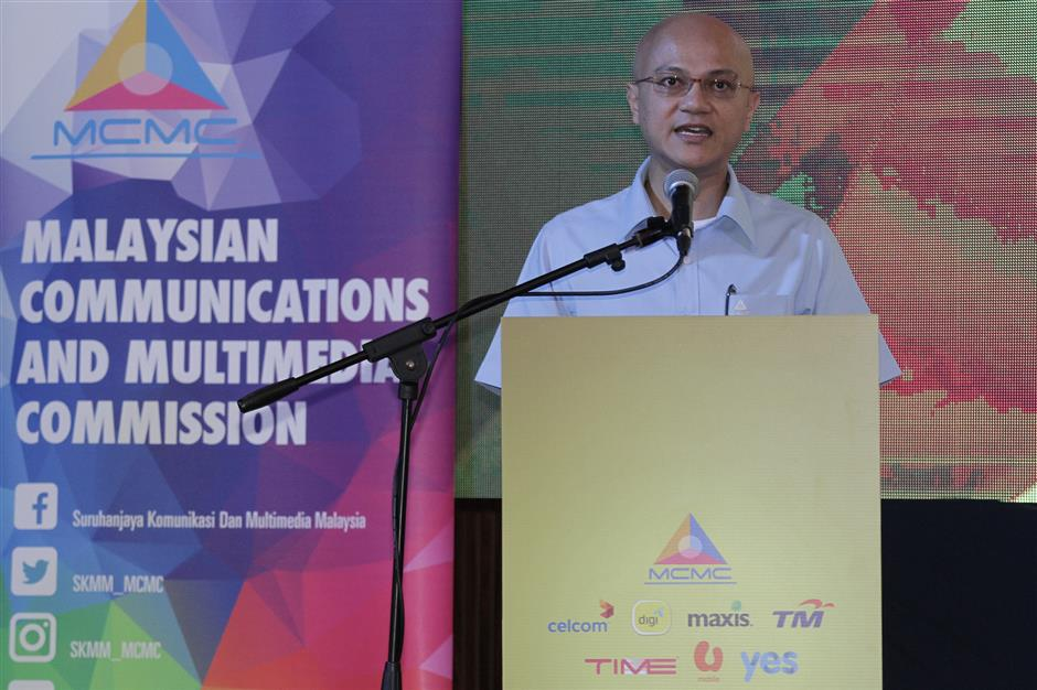 Malaysian Communications and Multimedia Commission (MCMC) chairman Al-Ishsal Ishak speaking at the pledge signing ceremony with malaysian telcos. YAP CHEE HONG/ The Star.