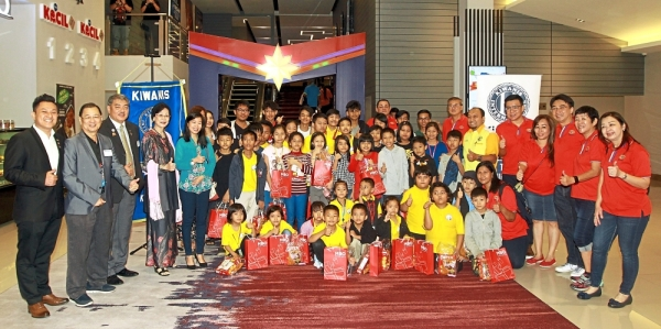 Underprivileged children with officials from the organisers and representatives from sponsors at the special movie screening at MBO in  Atria Shopping Gallery, Petaling Jaya.