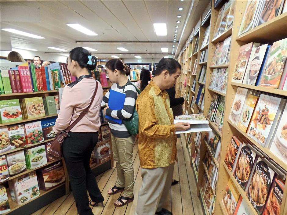 Spoilt for choice: Visitors reading and considering books to buy.