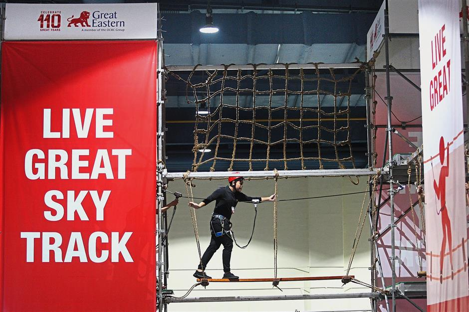 A visitor vertically challenging himself on the Live Great Sky Track set 6m above ground at the Star Health Expo 2018.