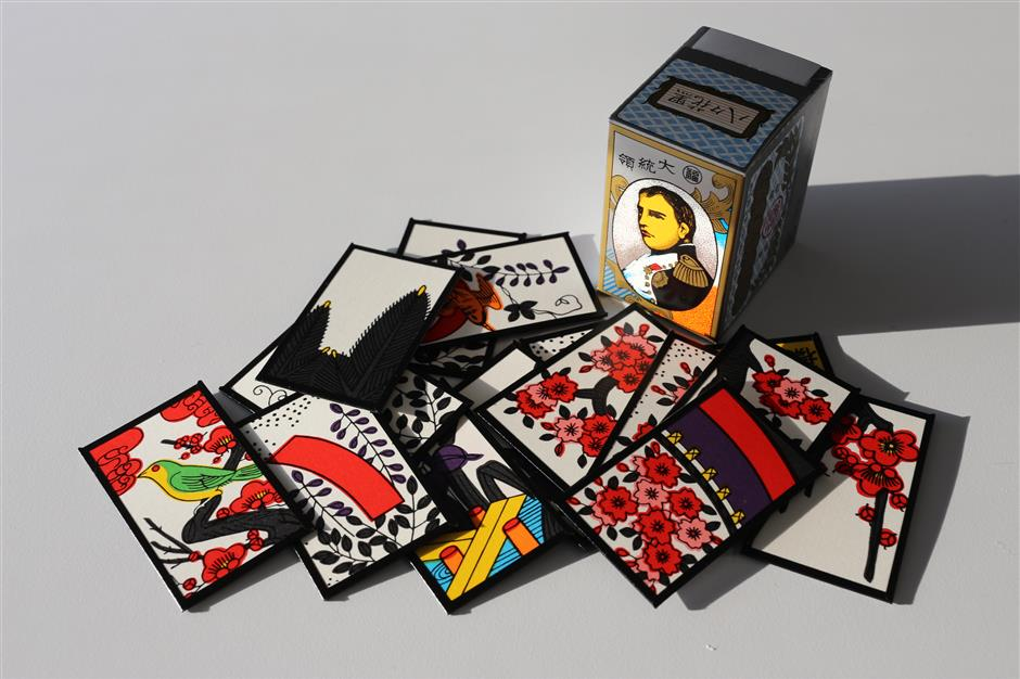 Nintendo Co. 'hanafuda' playing cards are arranged for a photograph in Tokyo, Japan, on Thursday, April 19, 2018. Nintendo got its start in 1889 as a successful manufacturer of 'hanafuda' - Japanese playing cards made out of stiff paper. Now the game maker is embracing the same materials for its next trick and starts selling on April 20 an unusual collection of attachments for its hybrid Switch tablet-console: cardboard add-ons called Nintendo Labo. Photographer: Takaaki Iwabu/Bloomberg