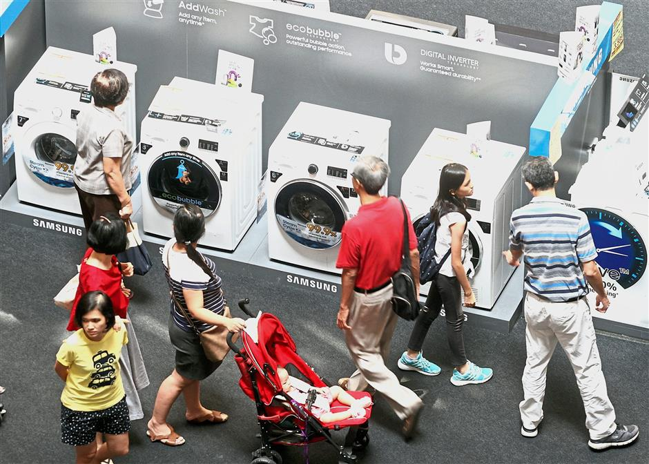Good time to shop: Retailers at 1 Utama Shopping Centre are enjoying brisk sales as many shoppers are hunting for electronic items such as washing machine, fridge, TV and others before the SST kicks in on Sept 1.