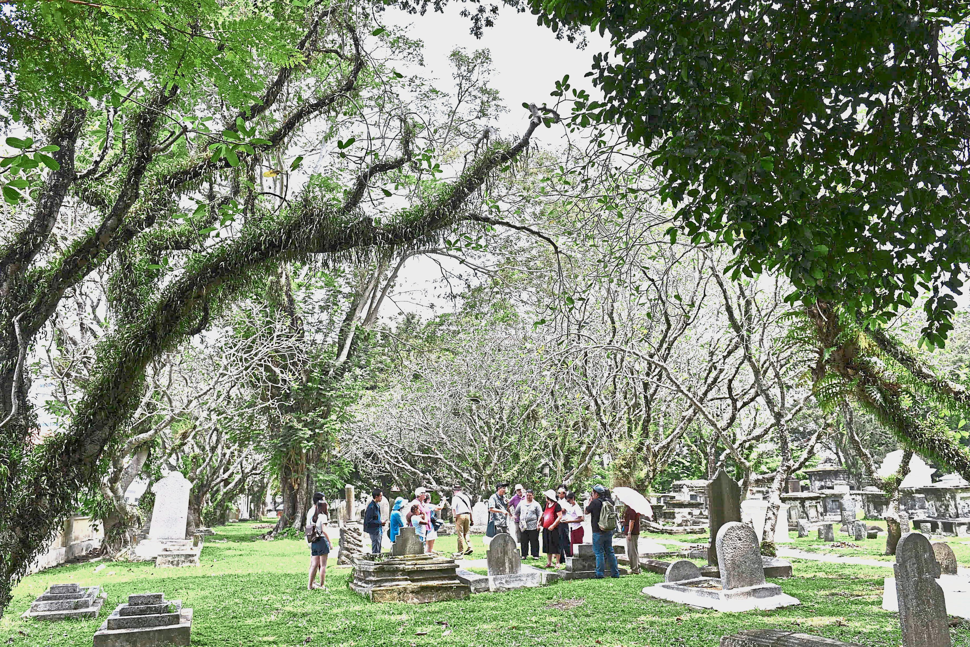 Visitors listening to stories about the illustrious personalities buried at the Protestant Cemetery in Jalan Sultan Ahmad Shah, George Town. — Photos: GARY CHEN/The Star