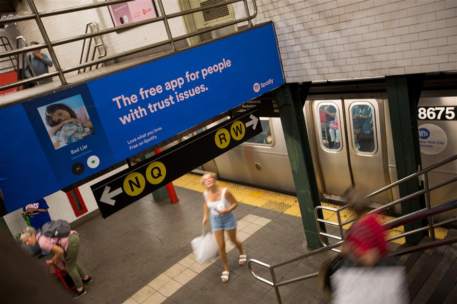 Commuters pass Spotify Technology SA advertisements displayed inside the Union Square subway station in New York, U.S., on Friday, May 25, 2018. In a testament to the growing power of the city\'s startup scene, upstarts have helped push up the price of certain subway campaigns sevenfold in the past five years and chased away many of the surgeons and lawyers advertisements. Photographer: Michael Nagle/Bloomberg