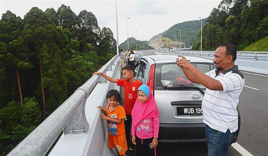 Md Faizal and his children were among eager Malaysians who tested the bypass on the first day of its opening.
