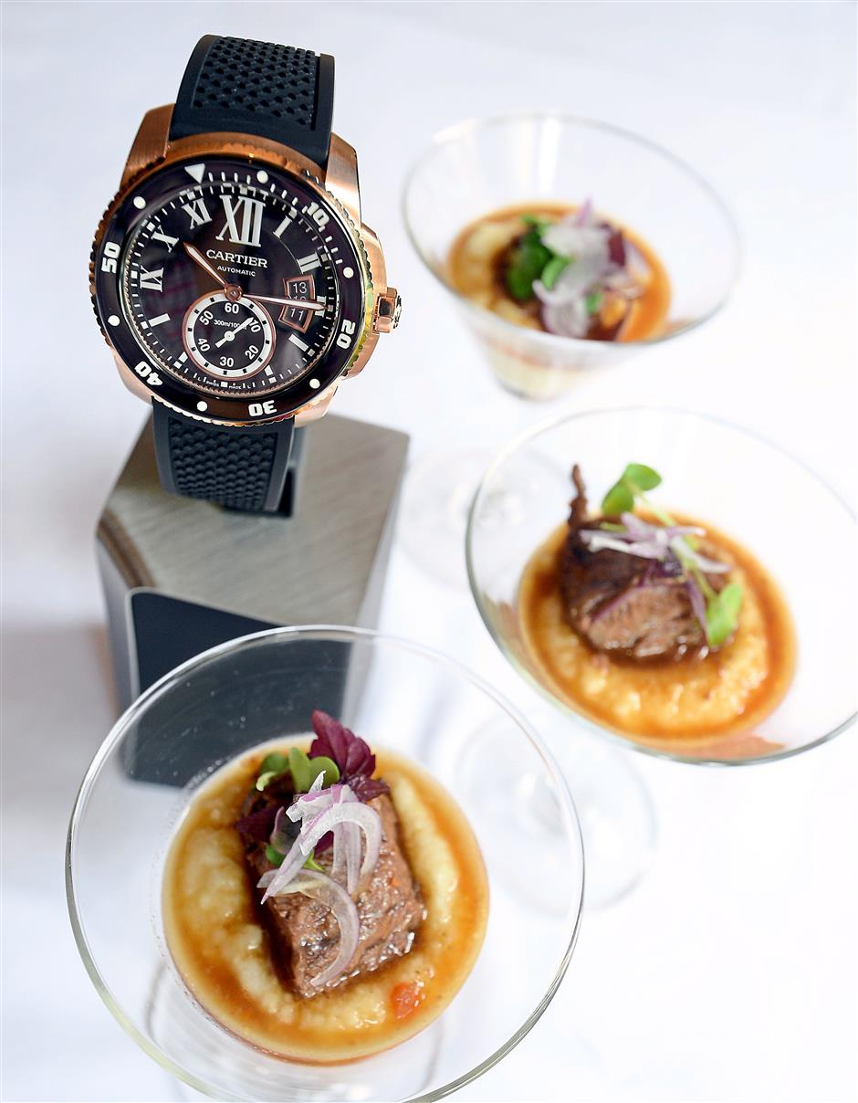 The Cartier Calibre de Cartier Diver Automatic Black Dial Rubber Mens Watch is to be paired with Beef Cheek on Parmesan Polenta and Cheese Foam. The Inspiration: The beef cheek, which represents the black dial, is served on top of a bed of polenta which mimics the rose gold case.