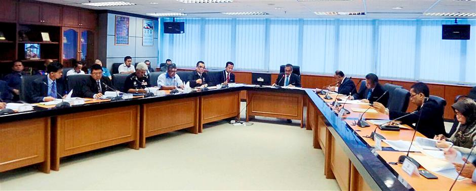 Good move: Sukarti (centre) chairing the first committee meeting of ESSZONE Resettlement in Kota Kinabalu.