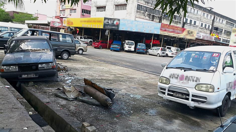 More parking bays are available for the public after workshop operators at Taman Sri Muda removed some of theabandoned vehicles.
