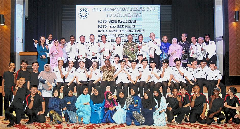 St John Ambulance management and student members at the North Selangor Area charity dinner in Klang Executive Club.