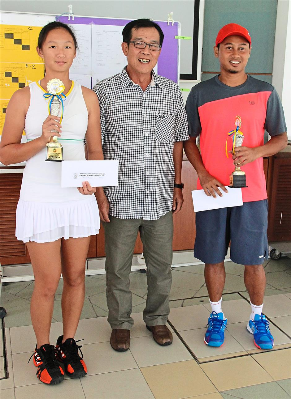 Well done: (From left) Michelle, Penang Lawn Tennis Association president Hang Kok Long and Muhammad Noor Noordin posing for the press after the prize presentation ceremony at the Penang Closed Tennis championship.
