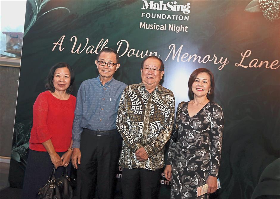 Star Media Group Berhad chairman Datuk Fu Ah Kiow (second from left) and wife Datin Chang Mun Lin (left) with MCA Public Services and Complaints Department head Datuk Seri Michael Chong (second from right) and wife Datin Seri Madeline Chong at Mah Sing Foundation's musical night.