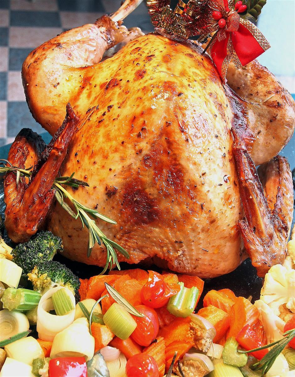 (Left) The roast turkey is marinated overnight with a combination of herbs and spices, and then slow-roasted to retain moisture.(Below) Diners can savour roast lamb leg, which is among the highlights of the Christmas Eve buffet dinner at Royale Chulan Seremban. u2014 Photos: UU BAN/The Star