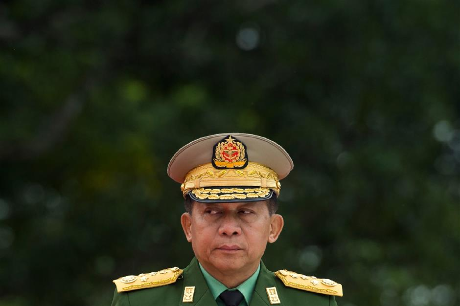 TOPSHOT - Myanmar's Chief Senior General Min Aung Hlaing, commander-in-chief of the Myanmar armed forces, arrives to pay his respects to Myanmar independence hero General Aung San and eight others assassinated in 1947, during a ceremony to mark the 71th anniversary of Martyrs' Day in Yangon on July 19, 2018. Myanmar observes the 71th anniversary of Martyrs' Day, marking the assassination of independence heroes including Aung San Suu Kyi's father, who helped end British colonial rule. / AFP PHOTO / YE AUNG THU