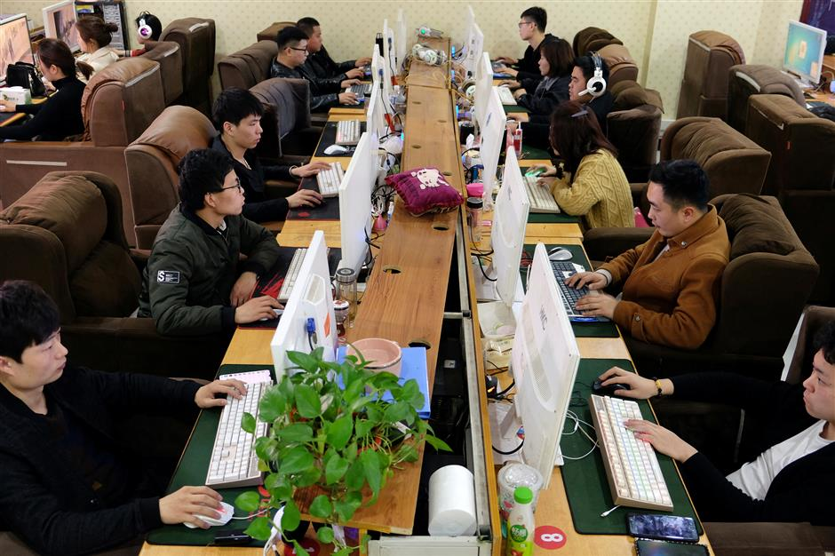 Employees work on labeling different items for data collection on computer screens, which would serve for developing artificial intelligence (AI) and machine learning technology, at the Qian Ji Data Co in Jia county, Henan province, China March 20, 2019. Picture taken March 20, 2019. REUTERS/Irene Wang NO RESALES. NO ARCHIVE.