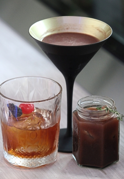 (Clockwise from left) Cocktails of Brown Bird (Diplomatico Mantuano, Chocolate Campari, lime and mango), Chocolate Rum (Diplomatico Reserva Exclusiva, Creme de Cacao, Chocolate Bitters and chocolate syrup), and Bitter Brew (Diplomatico Planas, Creme De Casis, chocolate Guinness syrup and ginger beer).