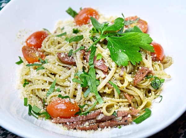 Anatra Affumicato has delicious smoked duck breast tossed with linguine and a pesto-based sauce.