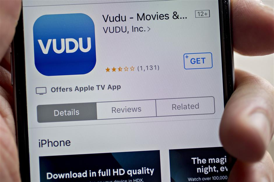 The Vudu Inc. application is seen in the App Store on an Apple Inc. iPhone in Washington, D.C., U.S., on Tuesday, March 27, 2018. Walmart Inc. has a vast arsenal at its disposal in its battle with Amazon.com Inc. -- stores, trucks, warehouses, even cloud-based data centers and a blockchain-enabled supply chain of fruits and vegetables. But there's one weapon it hasn't deployed: Vudu, the video-on-demand service it bought eight years ago. Photographer: Andrew Harrer/Bloomberg
