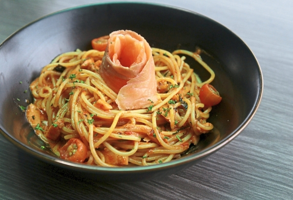 Sambal Smoked Salmon Pasta has a rich and spicy tomato sauce served with a decent portion of smoked salmon slices.