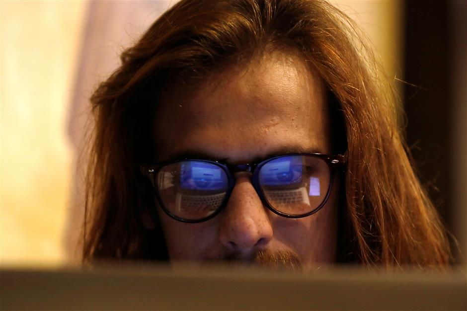 M Hanzala Tayyab, 24, a social media campaigner and cyber analyst, is seen working on computer at a local cafe in Islamabad, Pakistan March 13, 2019. Picture taken March 13, 2019. REUTERS/Akhtar Soomro