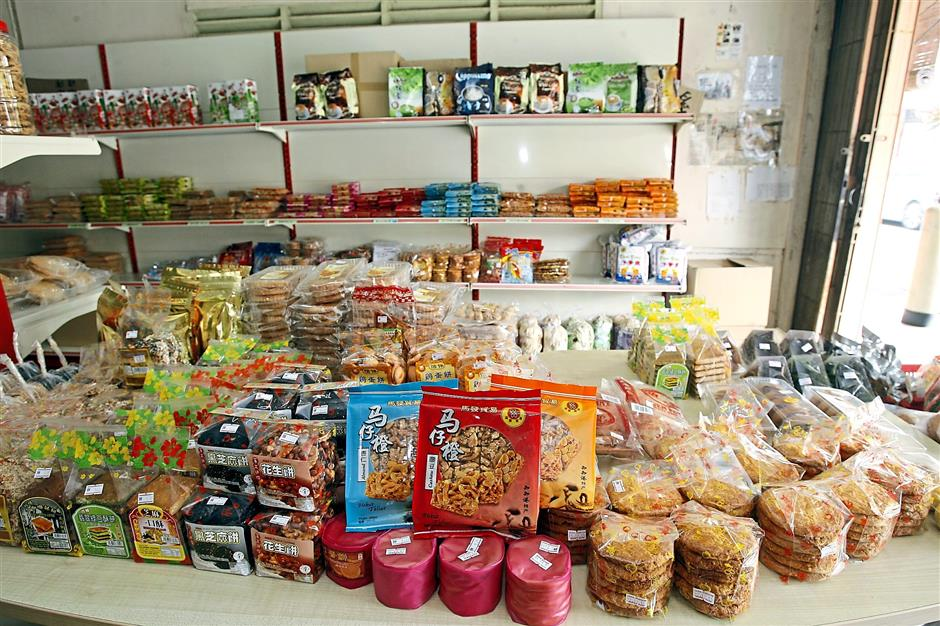 Various traditional biscuits, snacks and cakes on display at a shop in Titi.