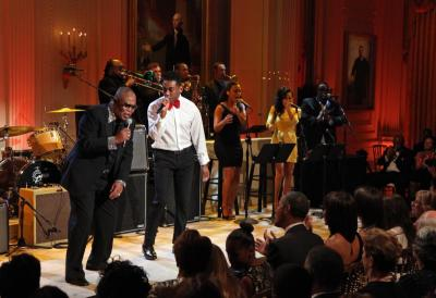 Sam Moore (left) and Joshua Ledet perform <i>Soul Man</i> for US President Barack Obama (front row, centre) during a concert of Memphis Soul music as part of the \'In Performance at the White House\' series, in the East Room of the White House in Washington, DC, USA on 9 April 2013. -EPA