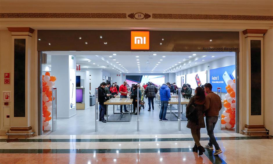 Customers enter a Xiaomi shop in a shpping mall in Barcelona, Spain February 28, 2018. Picture taken February 28, 2018. REUTERS/Yves Herman