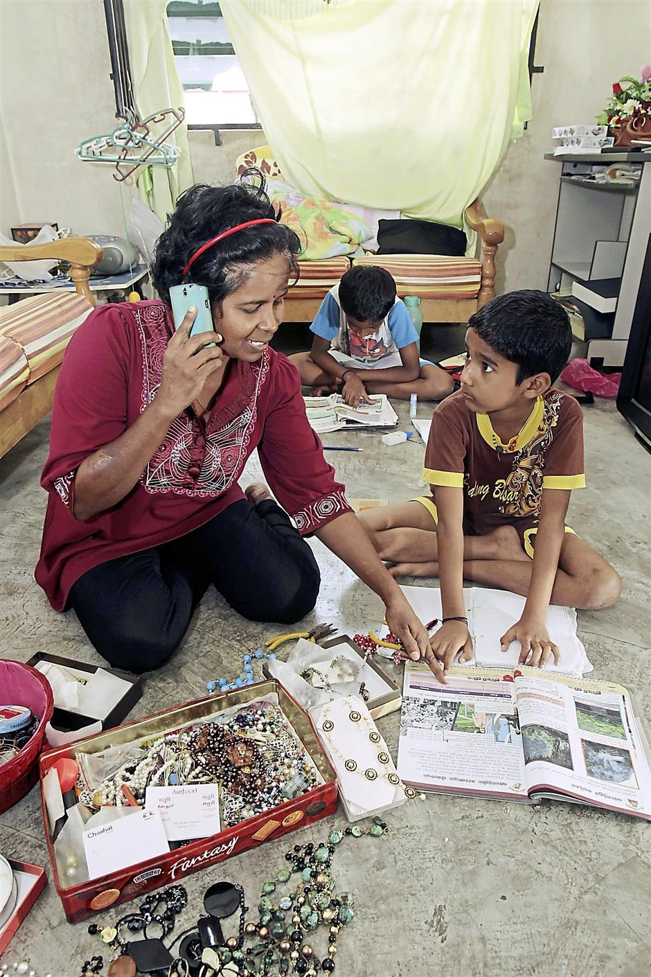 It took Sumathi a while to find a job that would let her balance between earning a living and being there for her children. Photo: ART CHEN/The Star