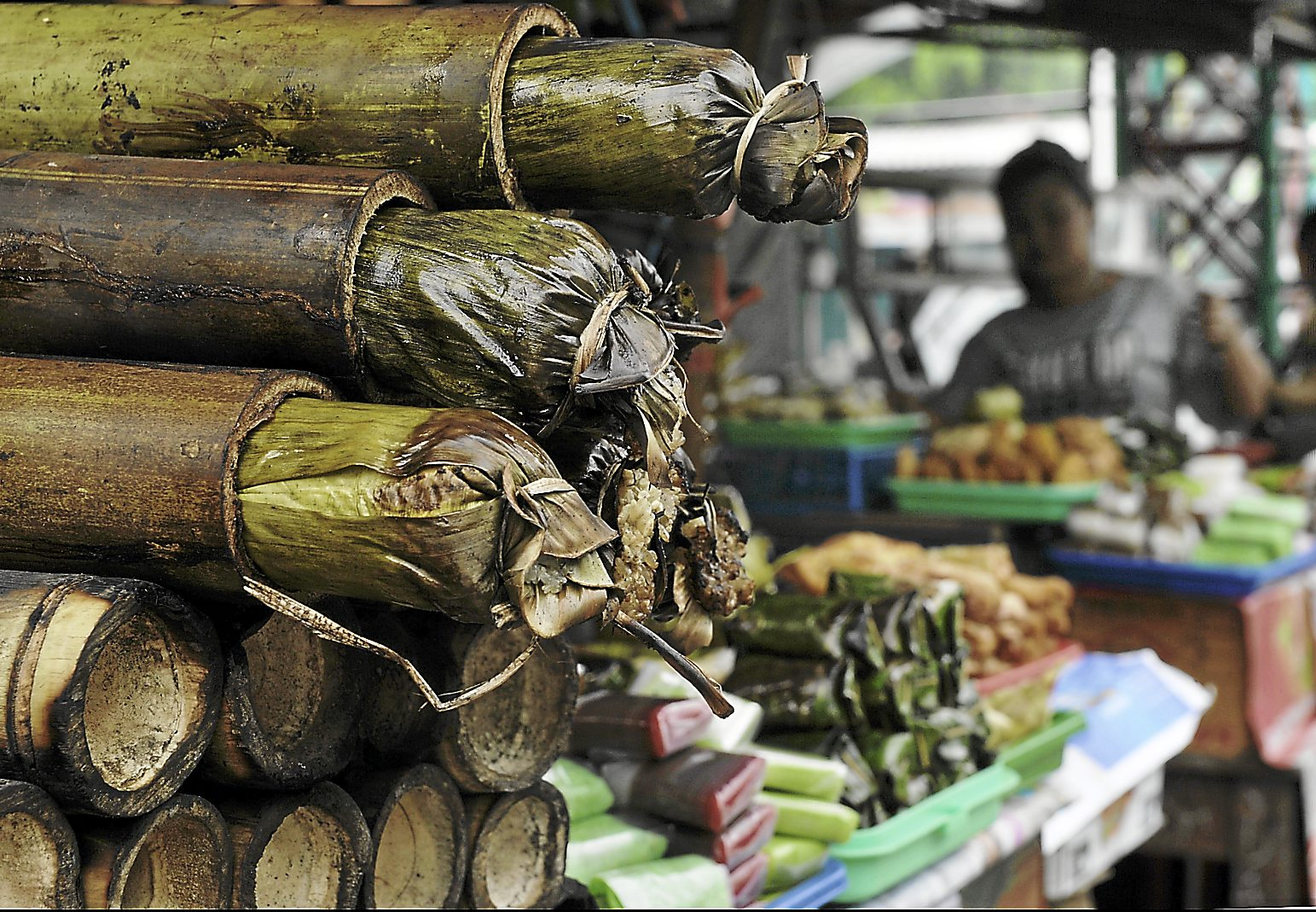 Here's something we're familiar with in Malaysia too. Lemang, which is glutinous rice cooked in bamboo over a wood fire, is sold at a stall in Jakarta, Indonesia, along with other sweet and savoury delicacies for breaking fast. - AFP