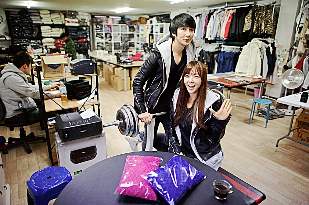 To go with Lifestyle-love-SKorea-fashion,FEATURE by Jung Ha-wonIn a photo taken on February 11, 2014 couple Baek Eun-Joo (R) and Lee Sang-Jun (L) who run 'Ggumddakji', an online shopping mall specialising in couples clothing, pose for a photo at their office in Seoul. Young South Korean couples often advertise their relationship by wearing matching outfits, whether socks, shirts, jackets or, more privately, underwear. The trend has spawned a small cottage industry, with specialist online stores offering