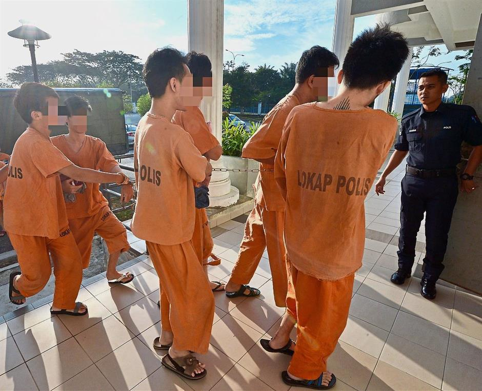 Serious offence: The six being brought to the Sepang court to be charged with drug trafficking.