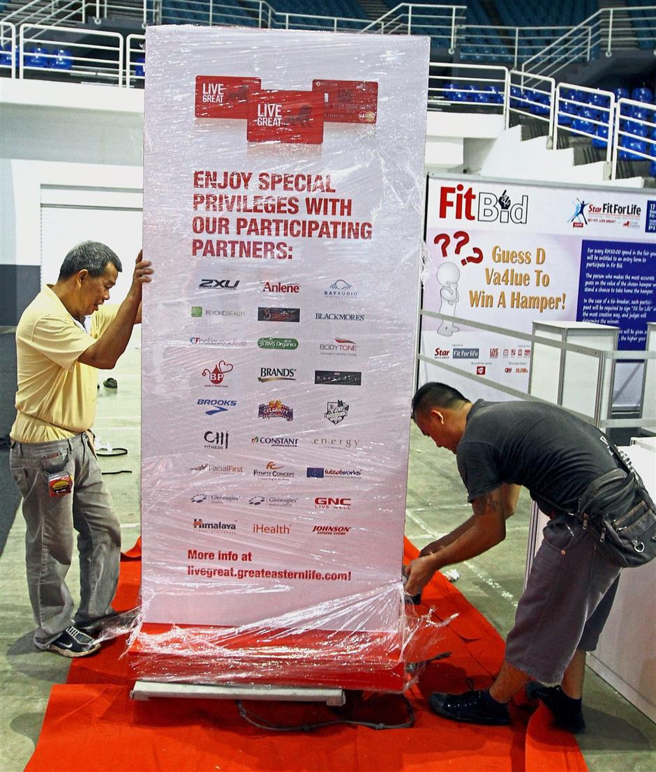 Getting ready: Workers setting up a booth for the event at Spice Arena in Penang.