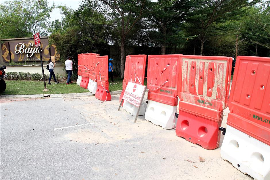 The entrance to the walking trail into Bukit Cerakah has been barricaded.