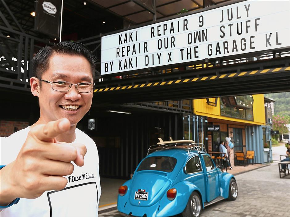 Lam outside the The Garage KL, one of two places the KakiRepair programme is hosted. u2014 Photos: KakiDIY