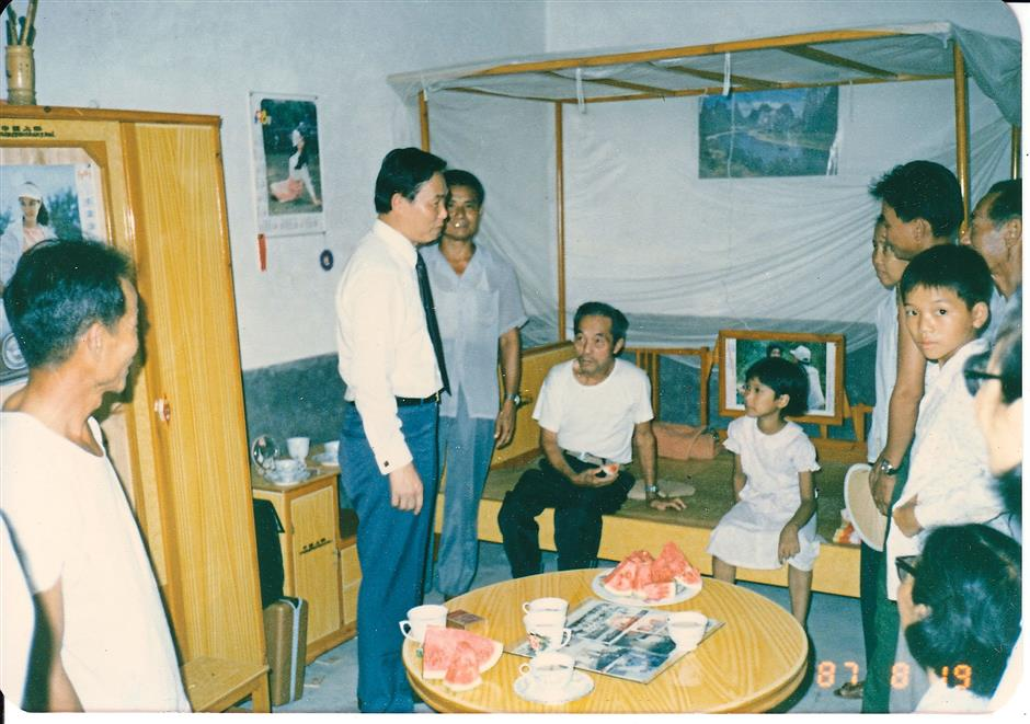 Remembering his roots: Tiong giving donations in Minchiang, Fuzhou, where his ancestors came from, in 1986.