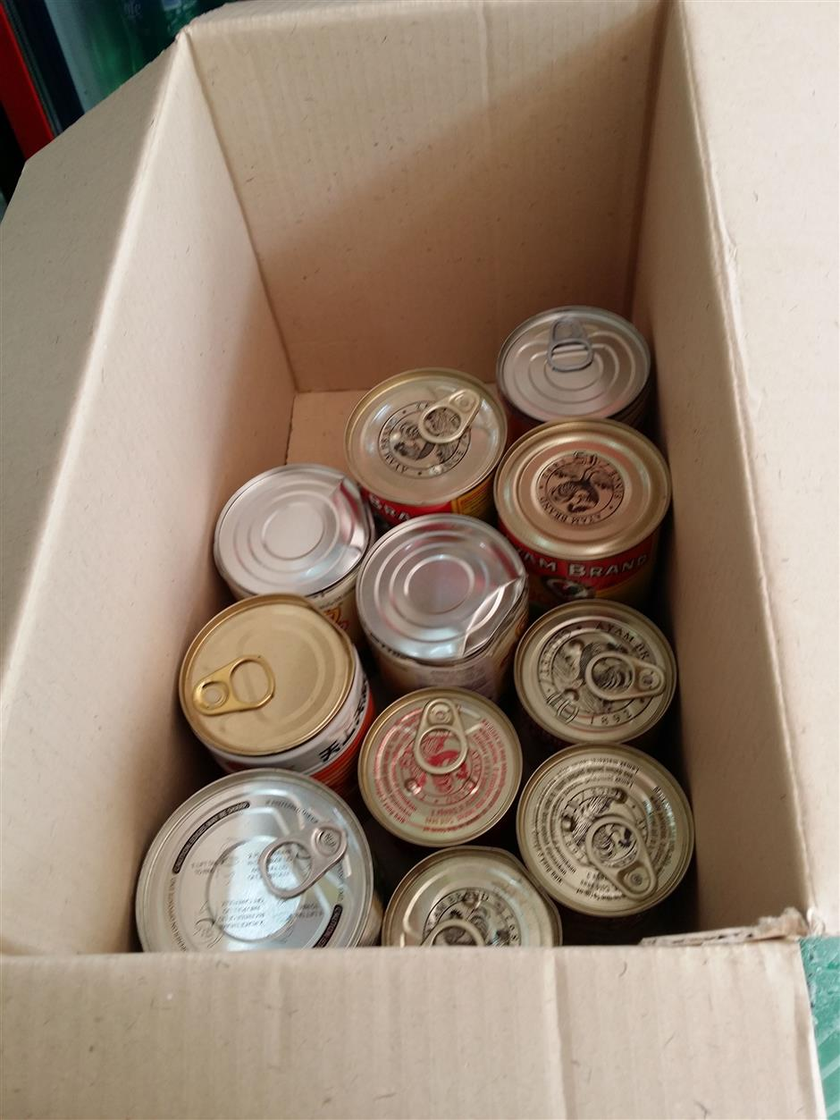 Dented seized cans collected from two shops in Section 7 Shah Alam were destroyed by MBSA.